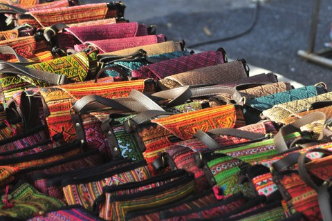 Hill-tribe handbags anyone? Photo taken in or around Night Bazaar, Chiang Mai, Thailand by Mark Ord.