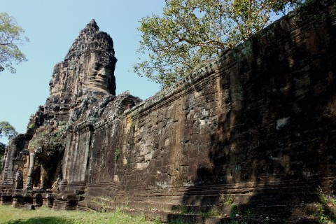 The wall has largely survived the torments of time. Photo taken in or around Angkor Thom, Angkor, Cambodia by Caroline Major.