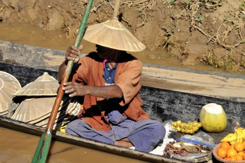 Floating vendor at work. Photo taken in or around Five-day markets, Inle Lake, Burma_myanmar by Mark Ord.