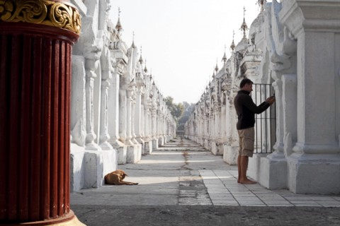 The book is of interest to readers of all levels and species. Photo taken in or around Kuthodaw and Sandamuni pagodas, Mandalay, Burma_myanmar by Christopher Smith.