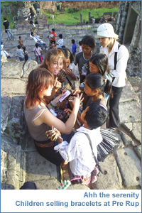 Children selling bracelets at Pre Rup before sunset