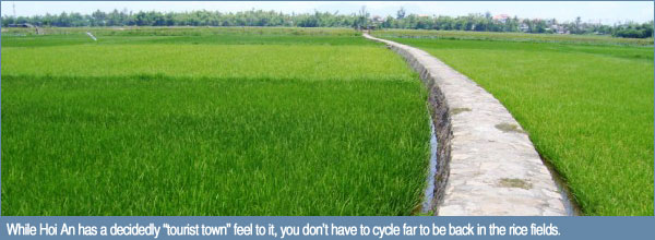 "While Hoi An has a decidedly ""tourist town"" feel to it, you don't have to cycle far to be back in the rice fields."