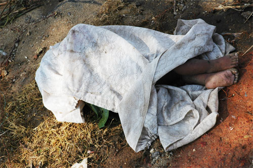Dead child covered by the side of the road in Galle