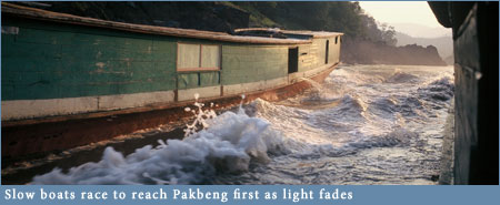 Slowboats racing into Pakbeng in fading light
