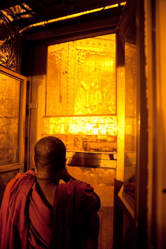 A monk, giving his respect to the Buddha hair relic.