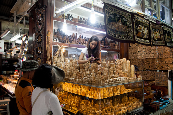 Sandalwood carvings and figurines on display