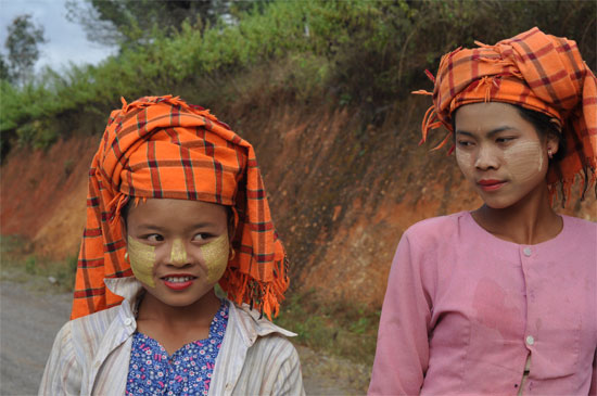 Local women on the way to a temple fair.