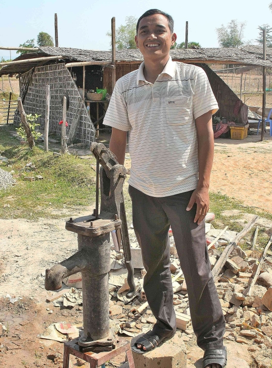 Founding father: Togh proudly shows off the new water pump at the village school