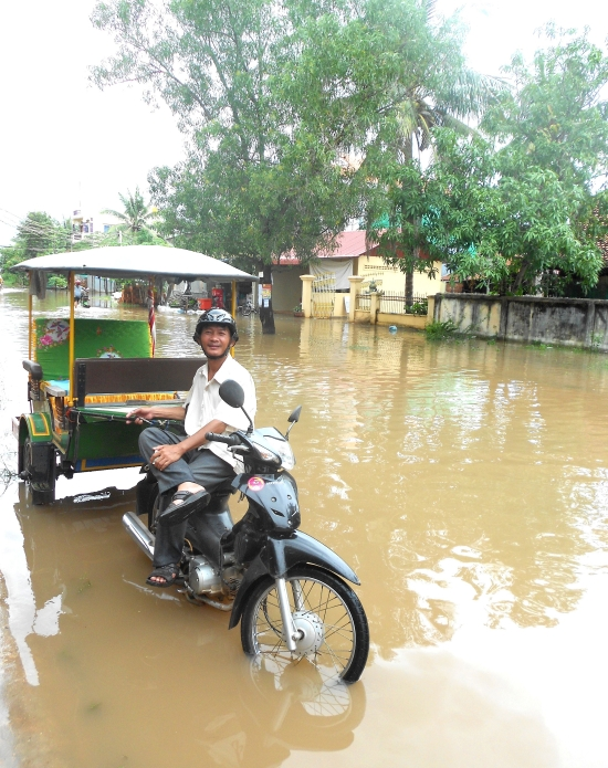 Your tuk tuk driver won't let a little thing like  a flood put him off.