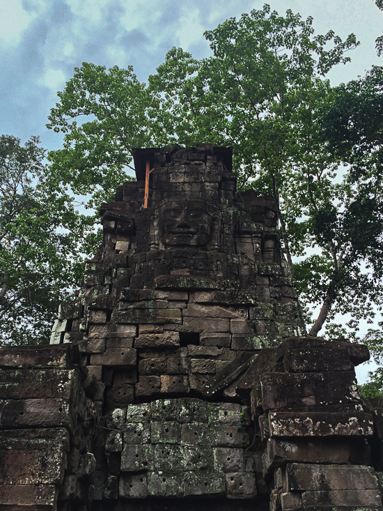 One of the four faces of Prasat Preah Stung.