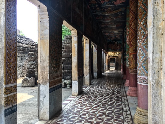 Shadowed walkways at Wat Nokor Bachay