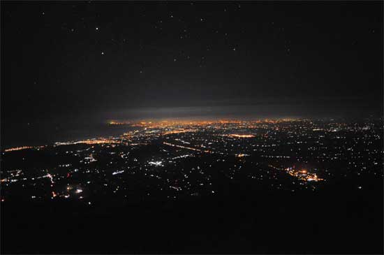 The view from higher up.The distant glow is Kuta, lower right is Besakih temple.