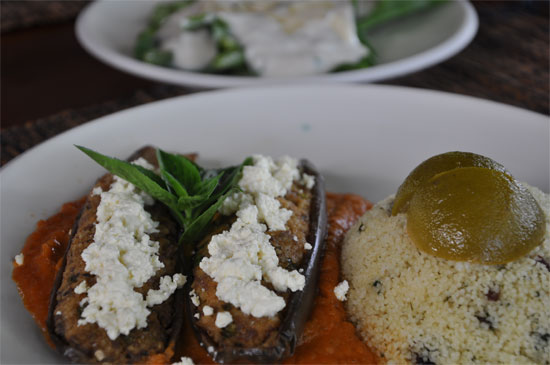 Baked eggplants on tomato sauce, filled with minced goat meat, topped with cheese, served with lemon and raison couscous and spinach and cashew nut salad with yoghurt dressing. 78,000 rupiah.
