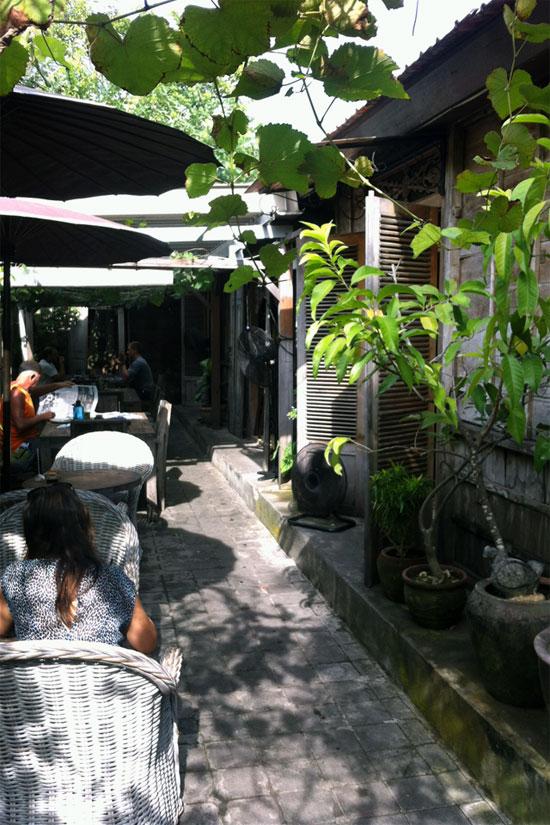 Outdoor seating down a narrow spot alongside the joglo.