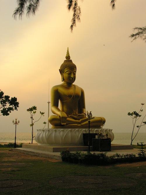 Buddha image on the sacred ground of Nam Kem beach.