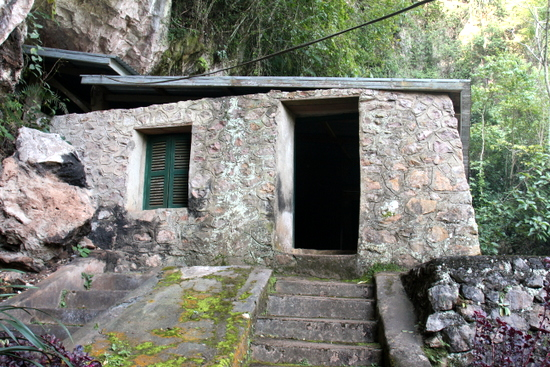 The entrance to someone's home in a cave