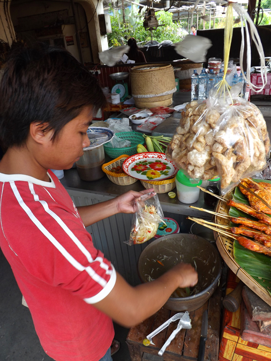 Road-side papaya salad is sold in small plastic bags. Denser than lettuce, a little goes a long way.