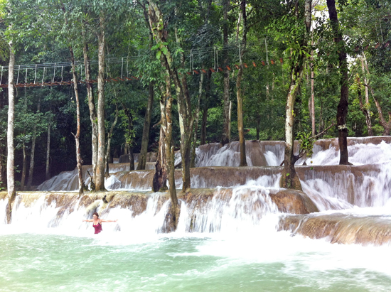 Cooling off in Tad Se Waterfall.