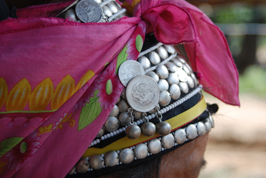 Akha women never take off their headdress. They protect it with a cloth while working or sleeping.