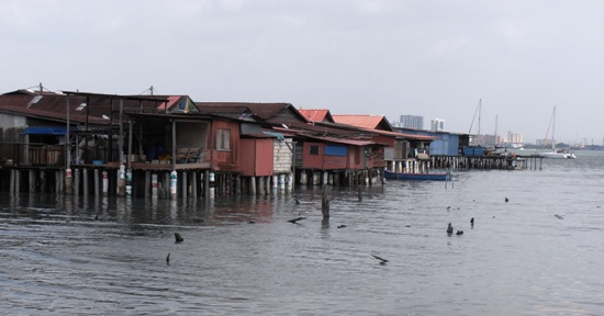 The clan jetties of Penang are whole communities built on stilts over the tidal mud flats.