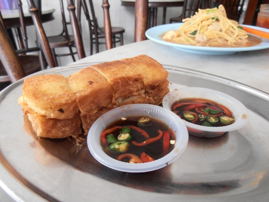 Deep fried roti babi with spicy dipping sauce.