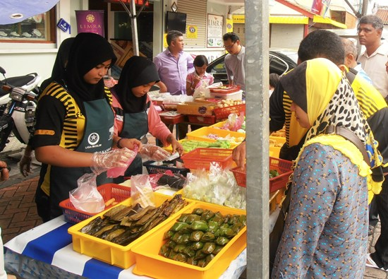 Sweet 'kuih bugis', wrapped in banana leaves and grilled, is a Ramadan treat.