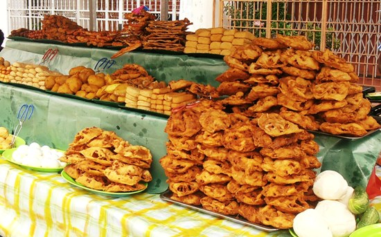 Stalls piled high with deep fried Indian snacks are quickly depleted when the day's fast ends.