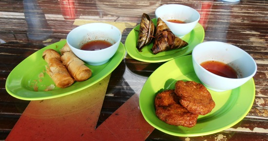 Snacks at the restaurant are cheap and cheerful: spring rolls, pandan chicken and Thai fish cakes.