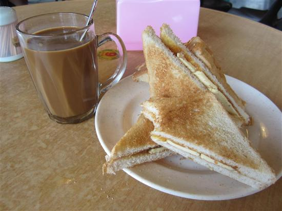 No, that's not a butter sandwich - it's kaya toast and kopi.