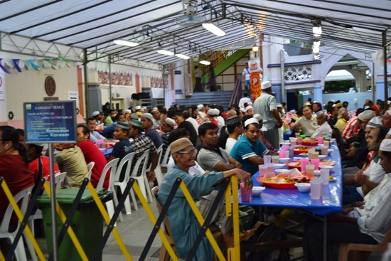Muslims prepare for an Iftar, or breaking of fast session at Sultan Mosque.