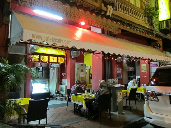 The Café le Caire assumes a lively vibe at night - and you can sometimes find its owner chilling out al fresco.