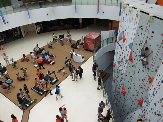 The Kallang Wave mall, whose boutiques are sports-themed, features a rock wall for the public to try climbing.