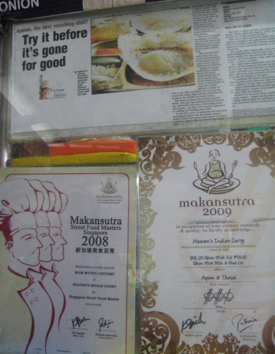 Hawkers proudly display their Makansutra reviews