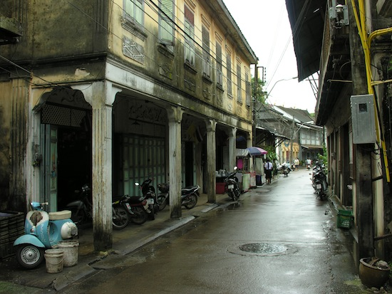 Dilapidated French architecture, puddles in the narrow streets, and vespas -- must be Chanthaburi.