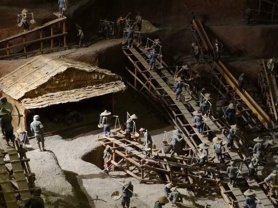 Mini diorama of an open-pit mine.