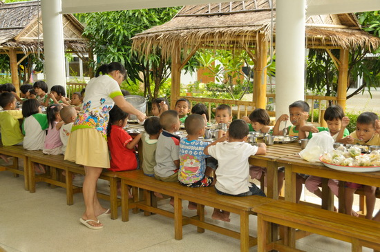 Meals are taken communally at the village's central courtyard.