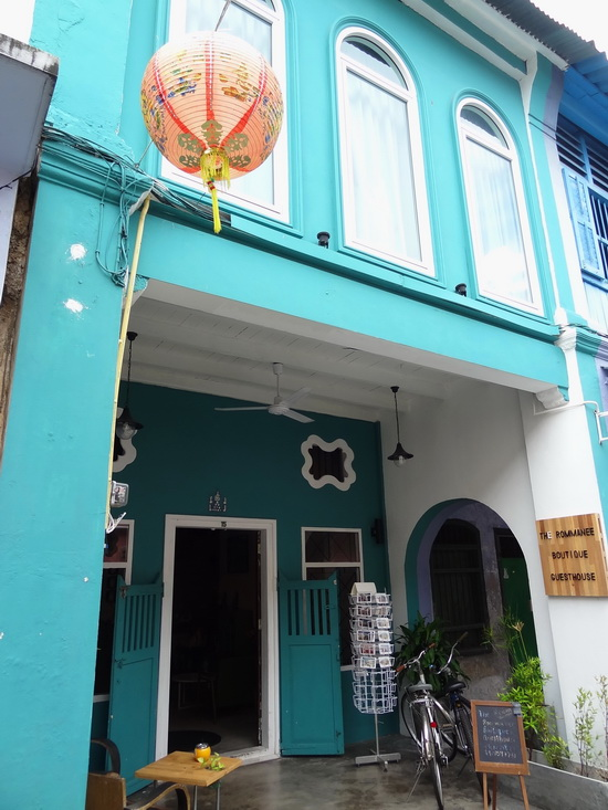This teal-green guesthouse is found in a row of pastel-toned shophouses.