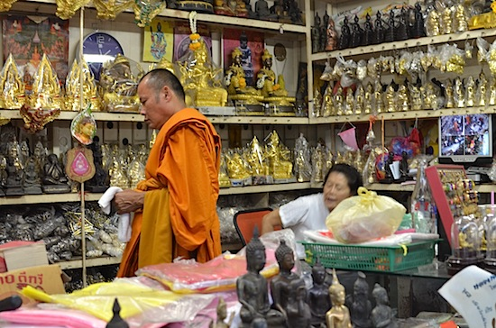 Many of the shoppers are monks.