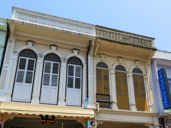 Freshly-painted shutters front the Sino-Portuguese façade.