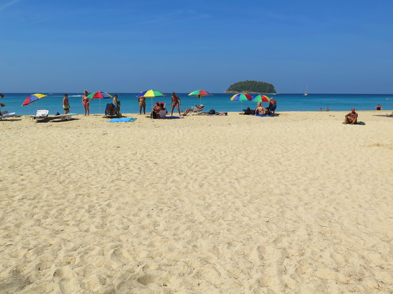 Kata beach in January: bring your own brollies.