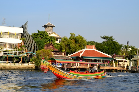 One of Bangkok's signature longtail boats in front of Chakrabongse Villas.