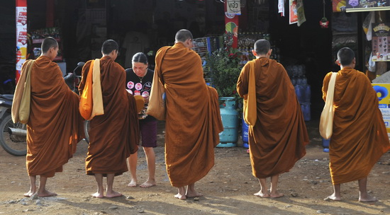 The monks collecting alms aren't a market fixture - they just happened to be passing