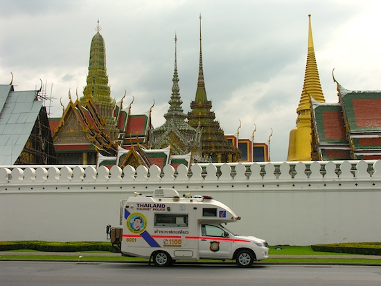 Some of Thailand's finest sit out front in a Tourist Police-mobile.