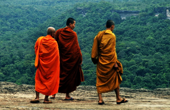Monks checking out Laos from the clifftop at Pha Taem.