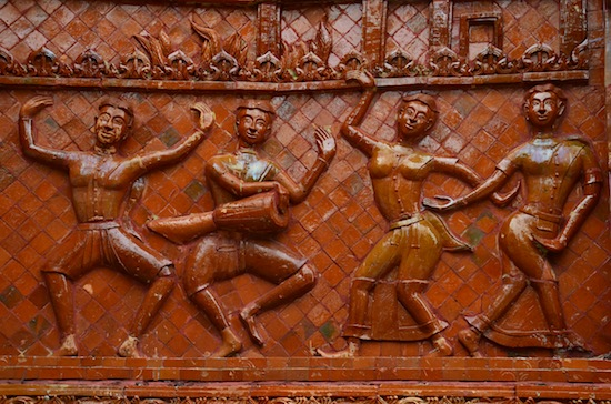 Isaan dancers and musicians on Wat Si Phradu's outer wall.