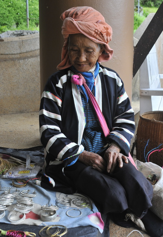 Black Lahu woman selling her trinkets outside the Nature Resort
