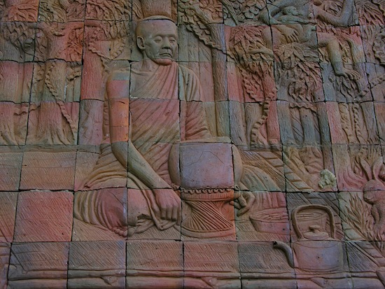 Depiction of Ajahn Mun contemplating before the day's only meal.