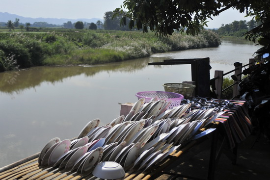 King Po Restaurant on the banks of the Nan. Not a bad spot to do the washing up?