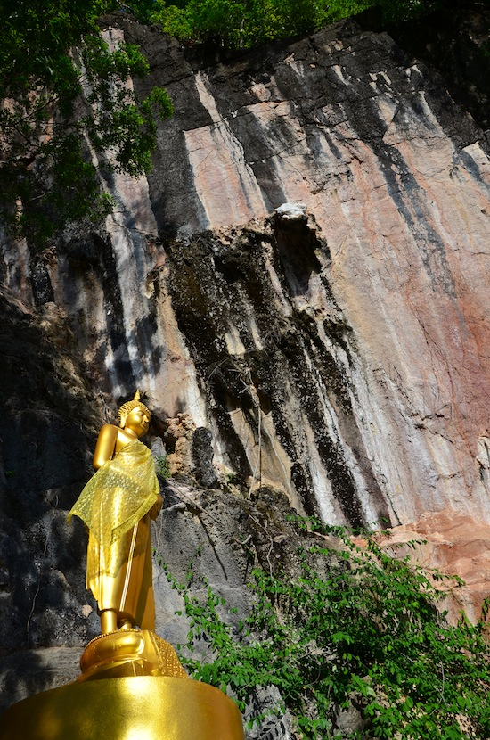 Buddha image in the rockclimbing posture.