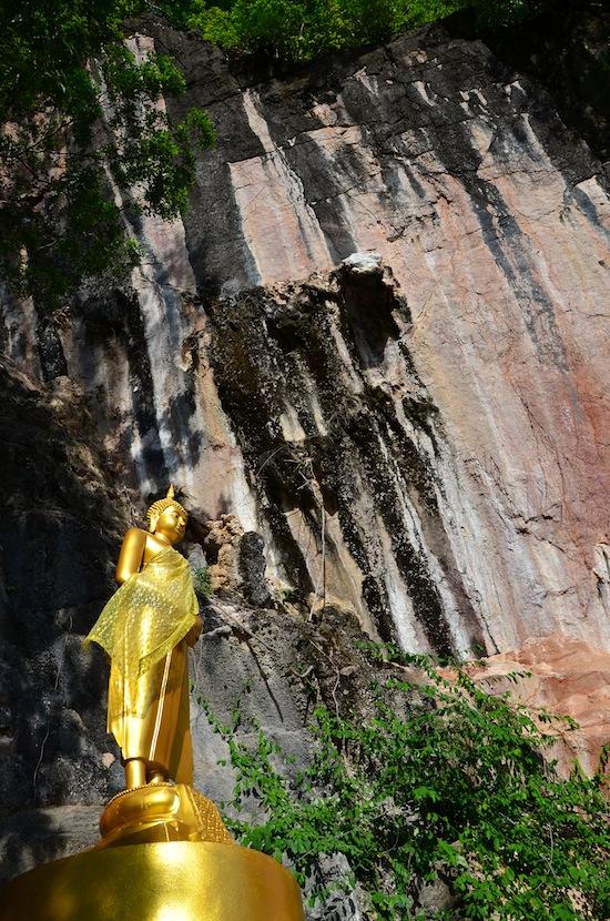 Buddha image in the rockclimbing posture.